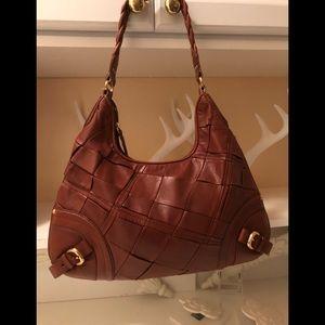 Elliott Lucca poor leather purse .